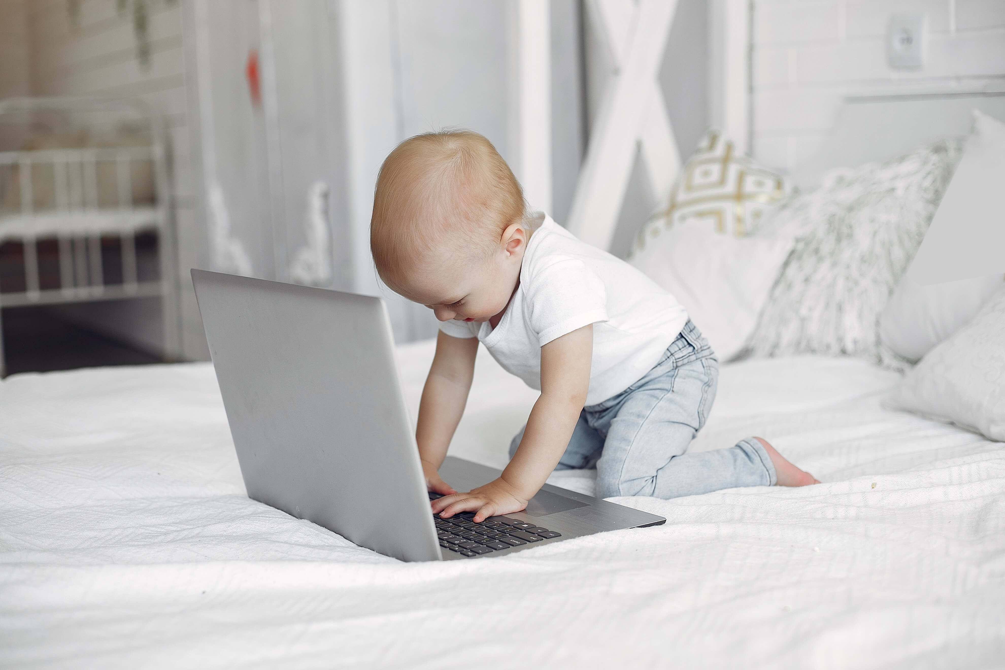 Baby playing on laptop